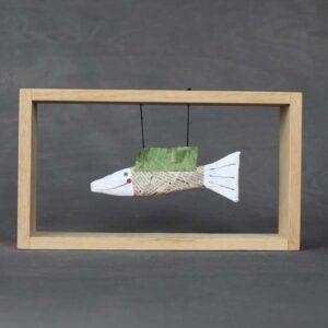 Novinová rybka v rámečku